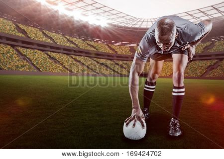 Rugby player taking position against rugby stadium with copy space 3d