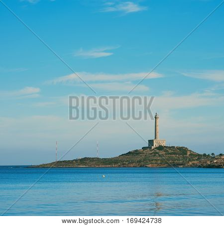 Cabo de Palos lighthouse in La Manga del Mar Menor. Seaside spit in the Region of Murcia Spain.