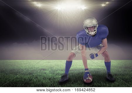 American football player in attack stance against spotlight with copy space 3d