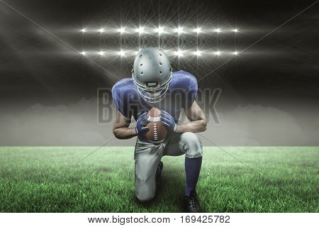 American football player kneeling against spotlights with copy space 3d