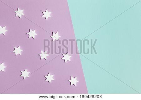 Modern geometric rectangular lilac and mint abstract minimal background with white stars, lying flat, top view, diagonal asymmetric composition. Have an empty place for your text.