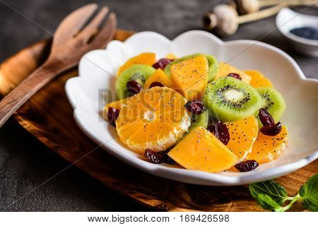 Fruit Salad With Minneola Tangelo, Kiwi, Persimmons, Cranberries, Sprinkled With Poppy Seeds
