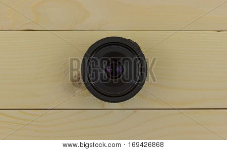 black lens with a large aperture of f2.8 STM on wooden background