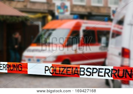 Police tape in Germany at the crime scene with the inscription in German