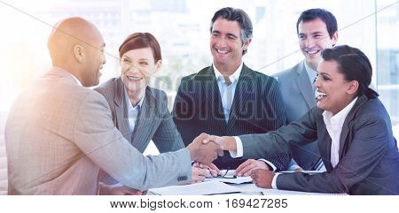 Business people greeting each other in a meeting