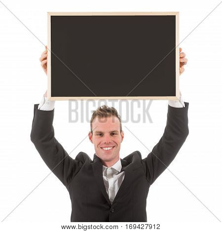 Business man holding empty chalkboard above his head isolated on white background