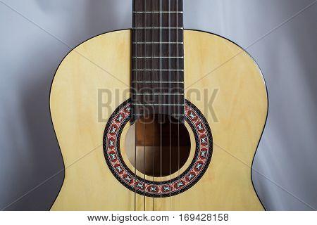 Guitar on wooden background fretboard, stringed musical instrument
