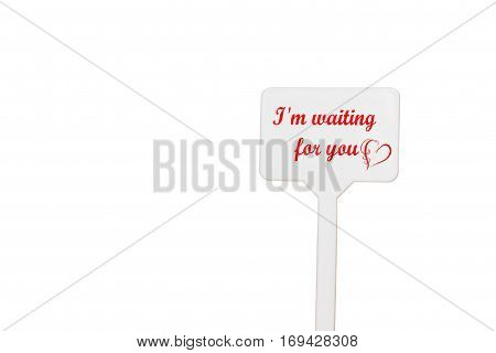 A table with a reminder note with the Valentine's Day, isolated on a white background