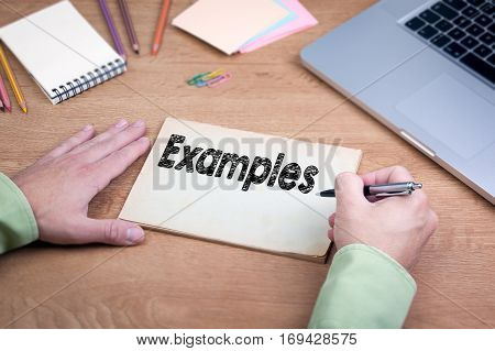 Hand writing Examples. Office desk with a laptop and stationery.