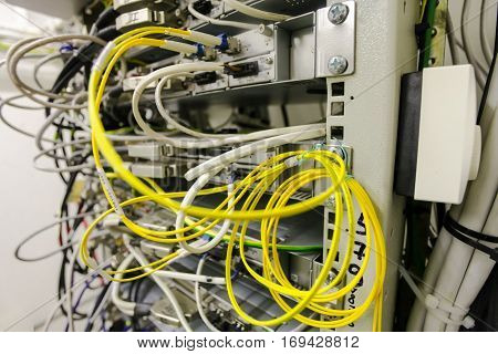 Equipment of radio base station yellow optic patch cords. Internet. Communication. Network