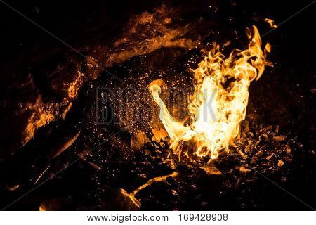 Fire of a charcoal forge, in an old smithy, where the iron was heated to malleable