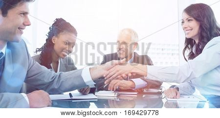 Young businesswoman and a coworker shaking hands during a meeting