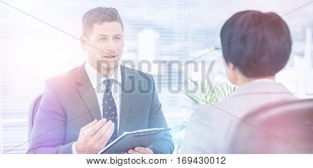 Male recruiter checking the candidate during a job interview at office