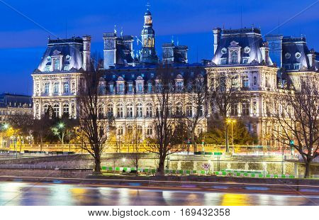 City Hall in Paris at night - building housing City of Paris administration. Building was constructed between 1874 -1882, architects Theodore Ballou and Edouard Deperta. France