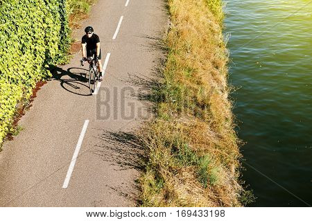Adult Man Riding Bike Above Aerial Near River France