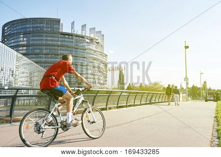 Senior Man Biking Sportive Strasbourg, European Parliament Building