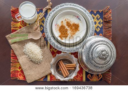 Rice pudding (sutlac) with milk rice cinnamon ingredients