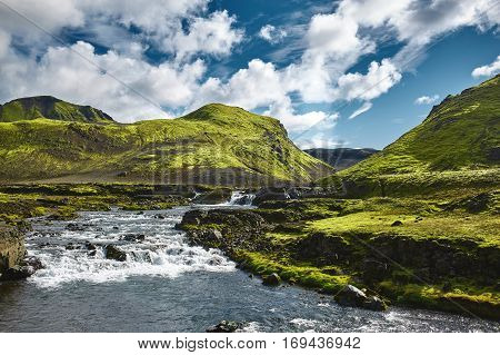 Travel to Iceland. Beautiful Icelandic landscape with mountains, sky, creek and clouds. Trekking in national park Landmannalaugar poster