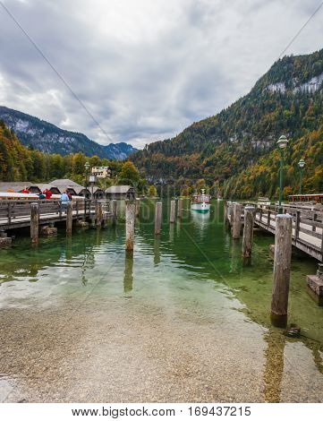 Berchtesgaden in Germany on the border with Austria. Famous lake Konigssee. Mooring for tourist pleasure boats