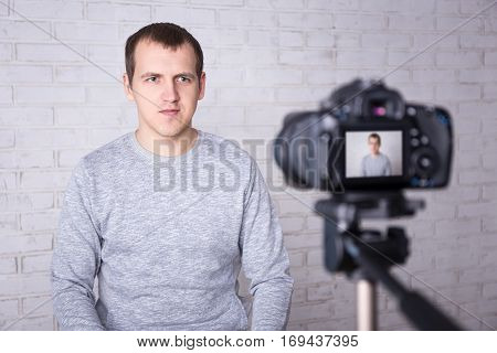 Young Man Blogger Recording Video At Home