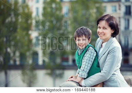 Mother and son having fun during summer vacation, Paris, France