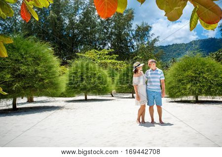 Young couple on Malibu beach at Koh Phangan Island during summer vacation, Thailand, Asia