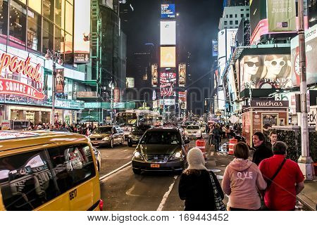 New York City - United States - 25.05.2014 - Times Square by night people walking around and Cars Taxi driving