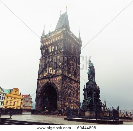Statue of Charles IV near Charles Bridge (1848) and bridge tower in the morning  mist