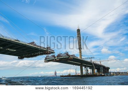 ST. PETERSBURG, RUSSIA: Construction of the bridge across river