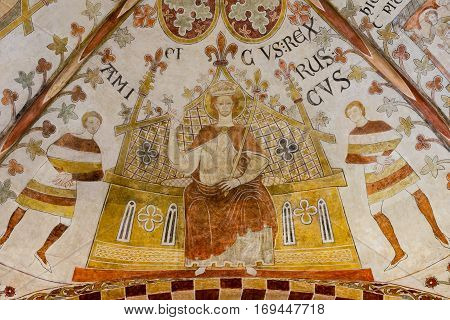 Erik Plovpenning on his throne, Romanesque fresco in St. Bendt church Ringsted, Denmark - February 20 2015