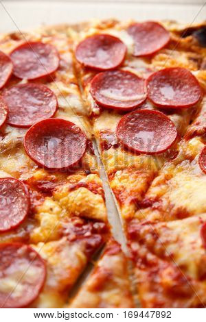 Pepperoni pizza. Hot homemade food. Sliced fresh italian classic salami pizza. Popular topping with cheese. Baked meal.