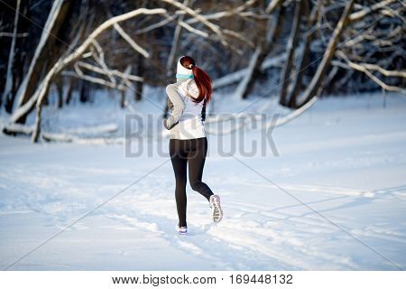 Girl on jogging in winter