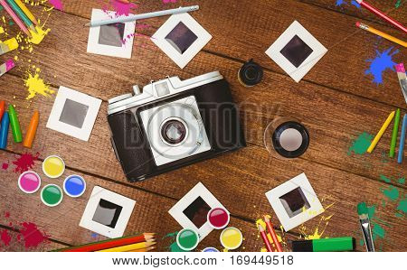 Frame of art supply against camera with transfer print on table