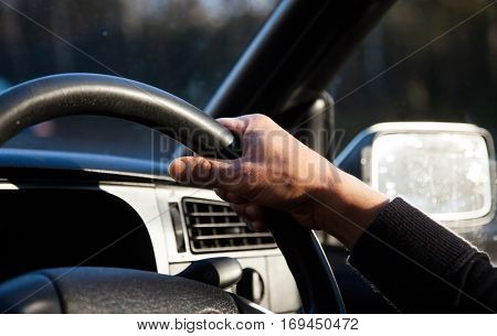close up on male hands on steering wheel - safe driving