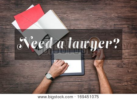 Man using modern laptop. Text NEED A LAWYER? on background