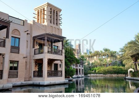 DUBAI UAE - SEPTEMBER 9: View of the Souk Madinat Jumeirah. Madinat Jumeirah encompasses two hotels and clusters of 29 traditional Arabic houses on September 9 2013 in Dubai UAE