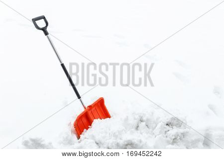 Winter shoveling with traces. Removing snow after blizzard. Shovel which cleaning snow.