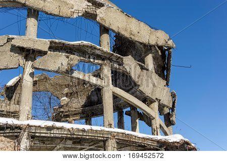 Facade of destroyed old building. Demolition of war concept.