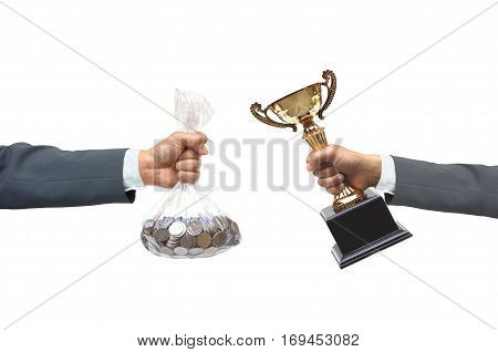Hand of a businessman buying a golden trophy from another businessman