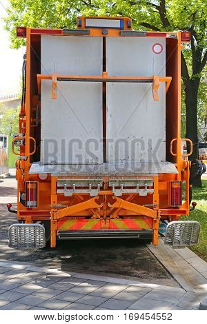 Waste Collection Loader at Rear of Garbage Truck