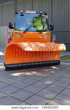 Snowplow at Orange Truck For Road Maintenance