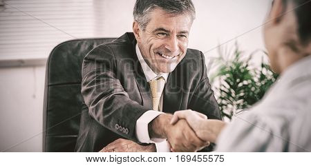 Businessman shaking a womans hand in the office