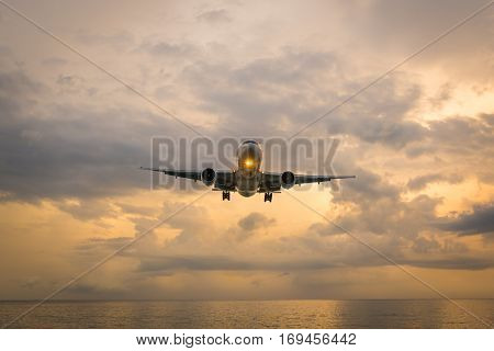 Landscape of sunset with Plane from Phuket at Nai Yang Beach Phuket Province Thailand.