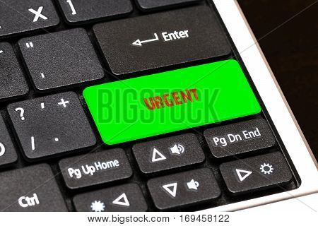 On The Laptop Keyboard The Green Button Written Urgent