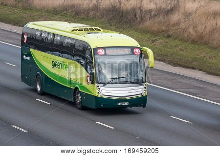 LONDON UK - FEBRUARY 6 2017: Greenline bus in motion on the British motorway M1