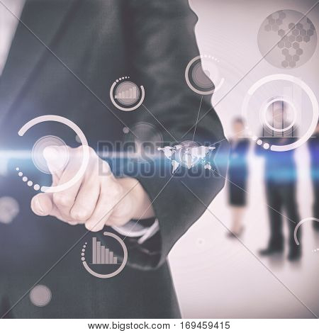 Businesswoman touching on digital screen with businesspeople standing in the background 3d