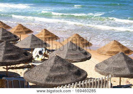Beach full of parasols, facing the mediterranean ocean in Trappeto, Sicily, Italy (Ciammarita di Trappeto)
