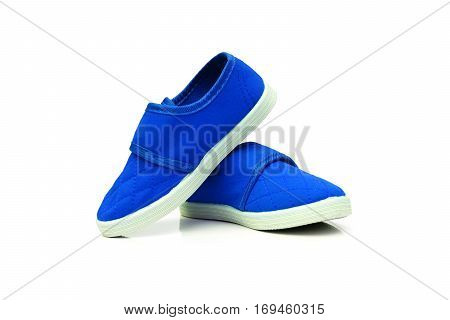 Blue slip on shoes isolated on white