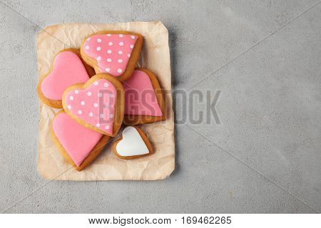 Valentine's day cookies on craft paper, top view