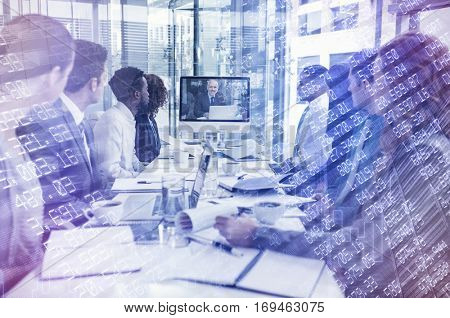Stocks and shares against focused business people looking at screen during video conference